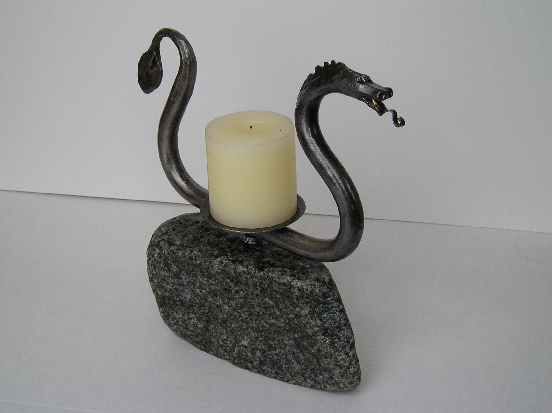 dragon candlestick in rock