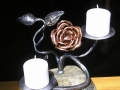 dual candles in rock with rose