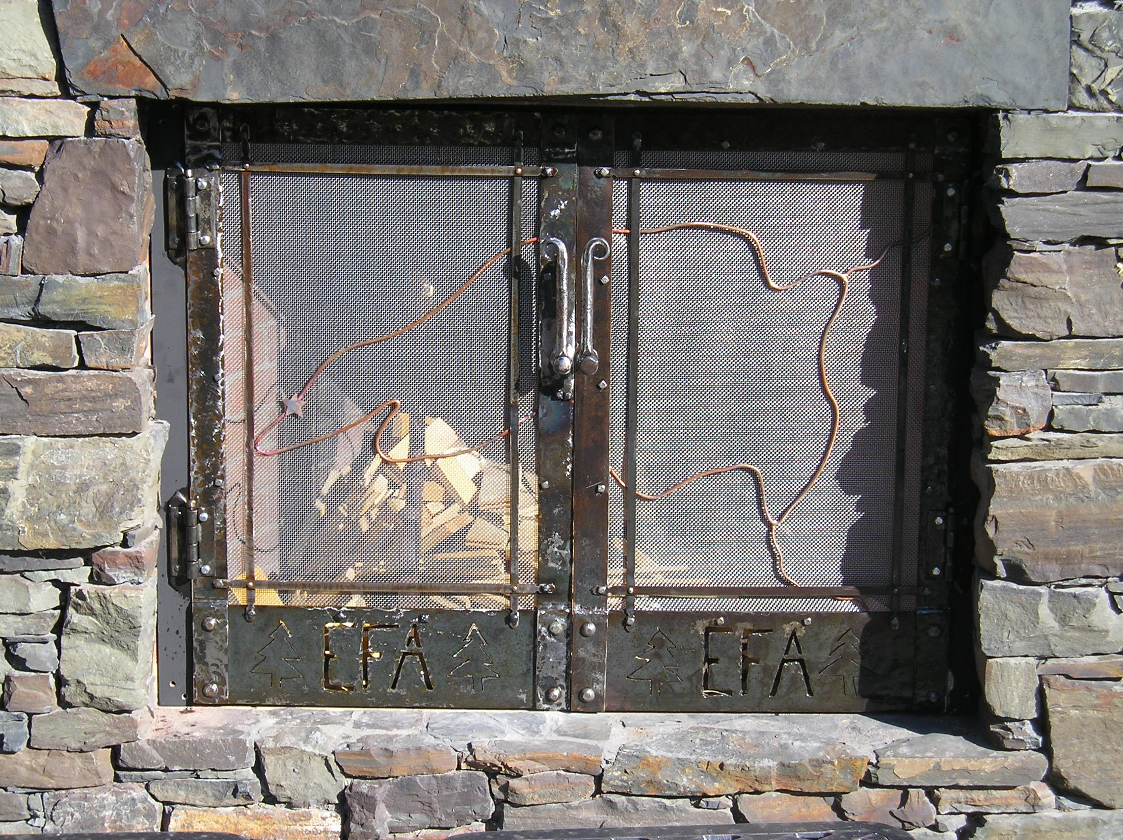 Closeup of outdoor fireplace doors.