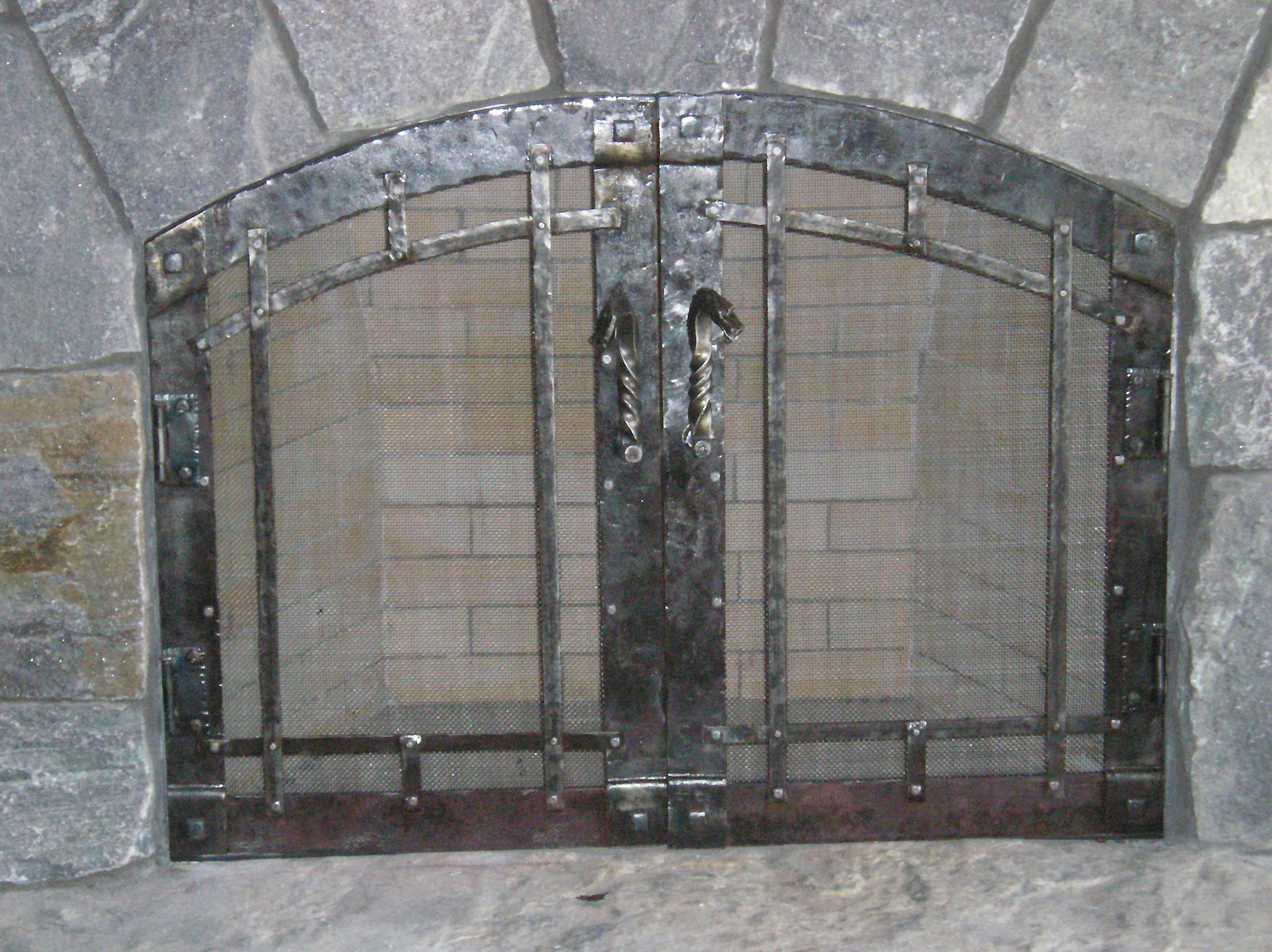 Front view of fireplace doors.