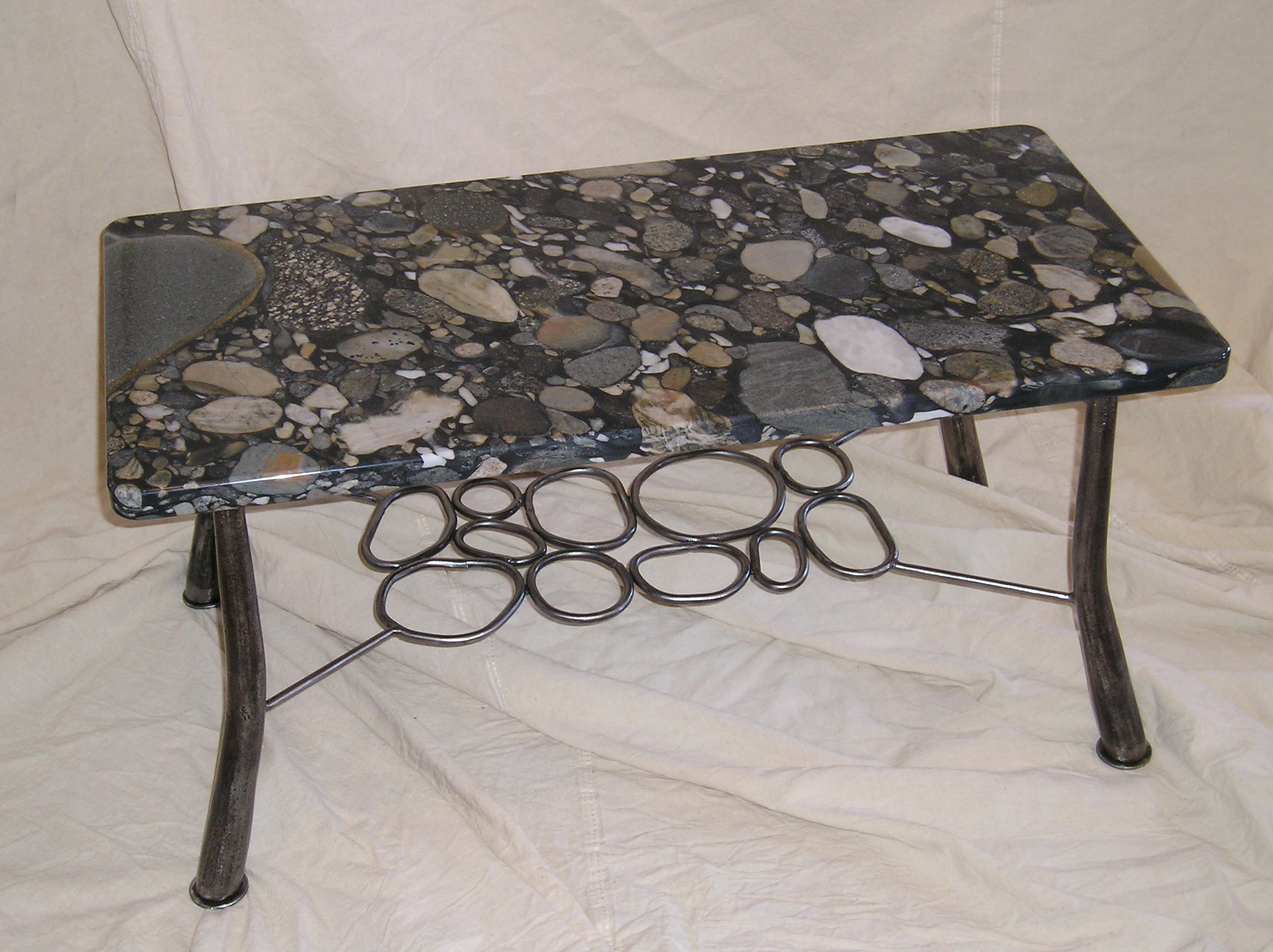 Marble top table with rock design below